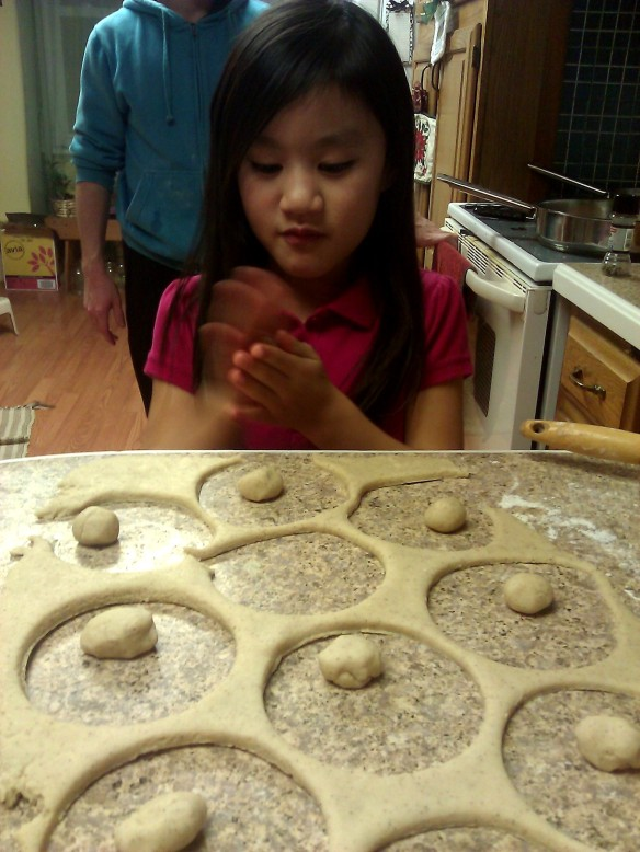 Jenna helps to make the donuts