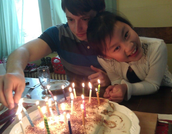 Tyler 21 and Jenna with bday cake